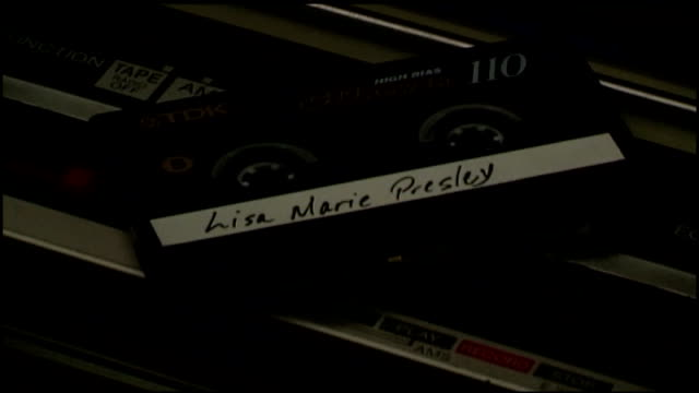 lisa marie presley cassette tape on top of boombox stereo - stereoanlage stock-videos und b-roll-filmmaterial