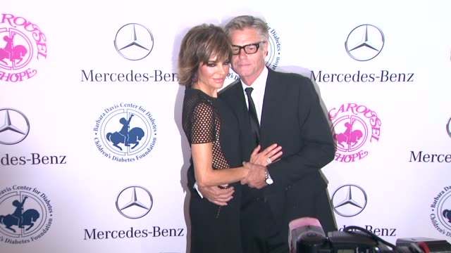 Lisa Rinna and Harry Hamlin at The 2014 Carousel Of Hope Ball at The Beverly Hilton Hotel on October 11 2014 in Beverly Hills California