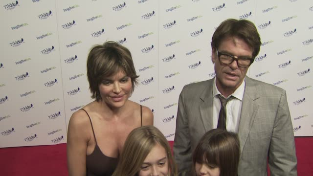 Lisa Rinna and Harry Hamlin at the Jonas Brothers to Celebrate the Launch of 77Kids at Los Angeles CA