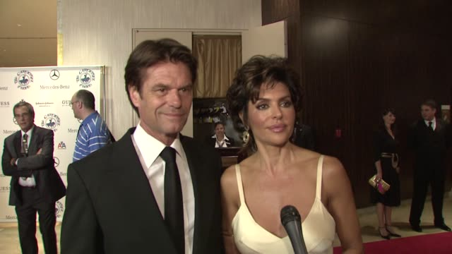 Lisa Rinna and Harry Hamlin on the event the evening's festivities honoring Pauletta and Denzel Washington at the 30th Anniversary Carousel of Hope...