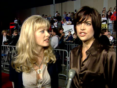 Lisa Rinna and unidentified actress talking to reporter on the red carpet