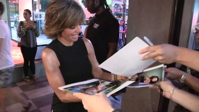 Lisa Rinna on Harry Hamlin while greeting fans at the Sham Ibrahim Art Exhibition in Hollywood in Celebrity Sightings in Los Angeles