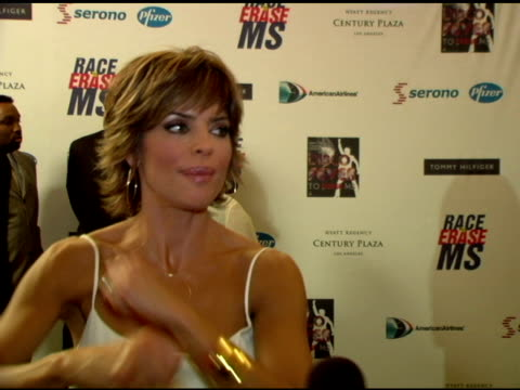 Lisa Rinna on modeling in the show dancing at the event what shes wearing the disco theme disco dancing at the 13th Annual Race to Erase MS red...
