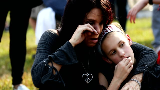 lisa schettino hugs her daughter madison schettino as they attend a rally for those heading to the march for our lives event in washington d.c. on... - march for our lives stock videos & royalty-free footage