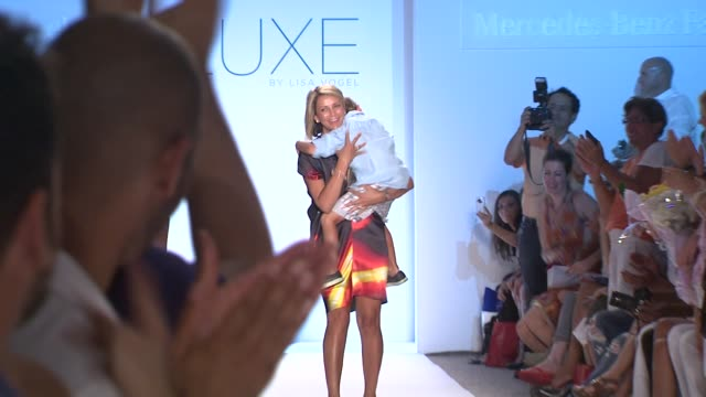 Lisa Vogel walks the runway during the Luxe by Lisa Vogel swimwear 2012 show at the Luxe by Lisa Vogel Runway MBFW Miami Swim 2012 at Miami FL