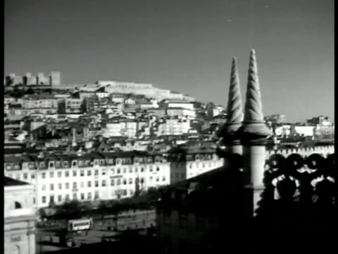 lisbon city. lisbon tower w/ spirals fg. cathedral like church. large ornate cathedral church. int cardinal walking up steps takes off hat to... - portugal stock-videos und b-roll-filmmaterial