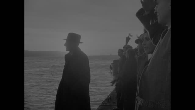 lisbon harbor. children passing through street barricade. cruiser ship the 'serpa pinto' leaving dock crowd waving w/ napkins. ship smoke stack.... - barricade stock videos & royalty-free footage