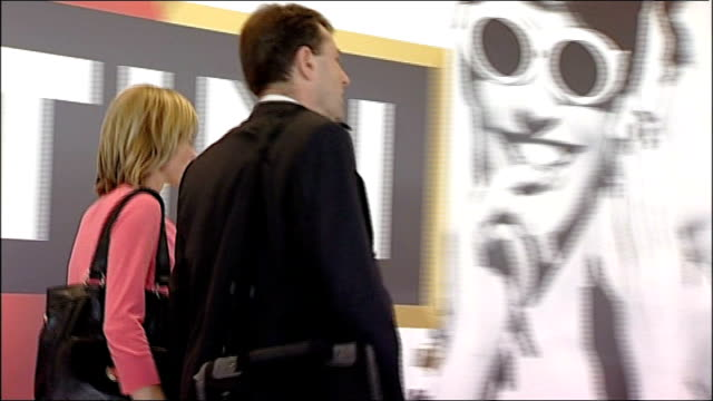 lisbon int gerry mccann and kate mccann along through airport mccanns along as respond to question from reporter sot - kate mccann stock videos & royalty-free footage