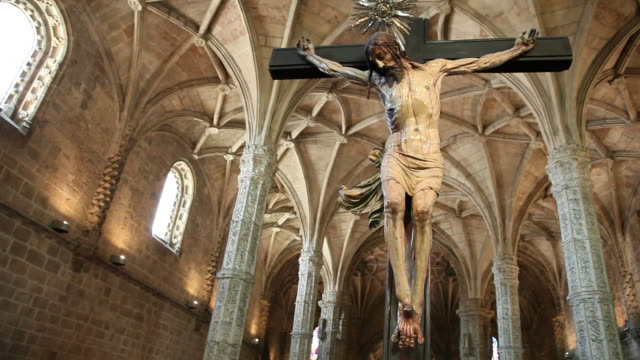 lisbon, jeronimos monastery, hieronymites monastery (mosteiro dos jeronimos), medieval christ sculpture in the church - cross stock videos & royalty-free footage