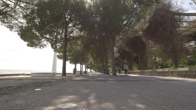 Lisbon Vasco Da Gama Couple running along path