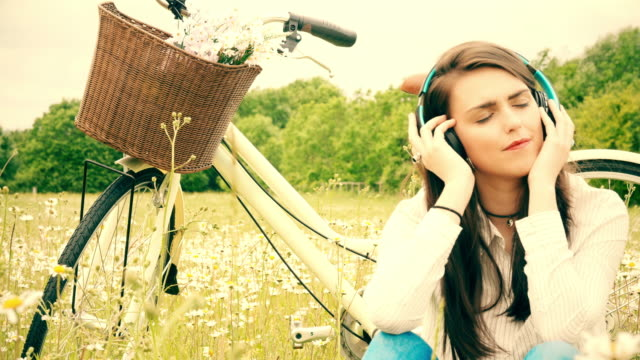 Listening to music, headphones. Bicycle ride rest.