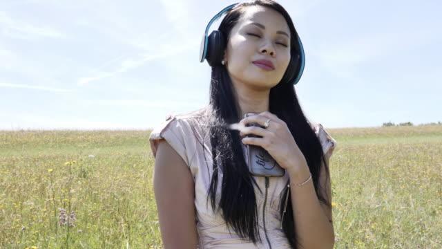 Listening to music, headphones. SM