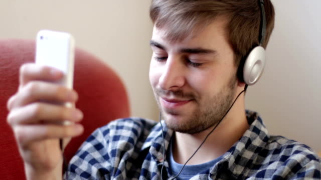 listening to music on headphones. at home. - nodding head to music stock videos and b-roll footage