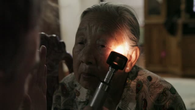 / listening to women's heartbeat / checking women's eyesight / listening to man's heartbeat Elderly laotians receive home checkups on January 05 2012...