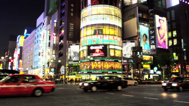 lit buildings at ginza at night, tokyo, japan - block form stock-videos und b-roll-filmmaterial