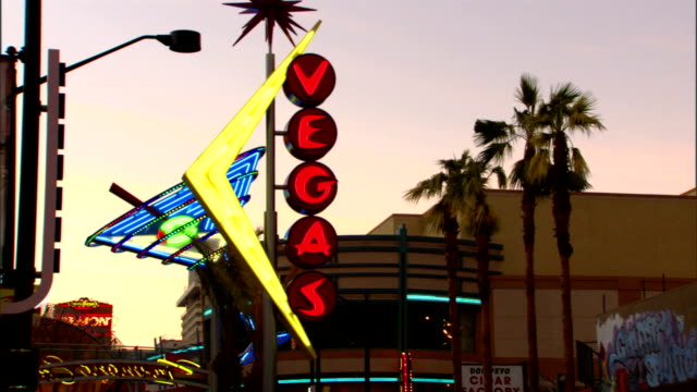 ws lit flashing neon lights of martini glass vertical sign vegas on fremont street nv downtown - martini glass stock videos & royalty-free footage
