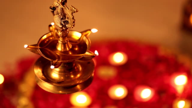 cu lit oil lamp during diwali festival - oil lamp stock videos & royalty-free footage