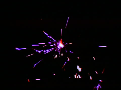 cu lit purple sparkler with black background - single object stock videos & royalty-free footage