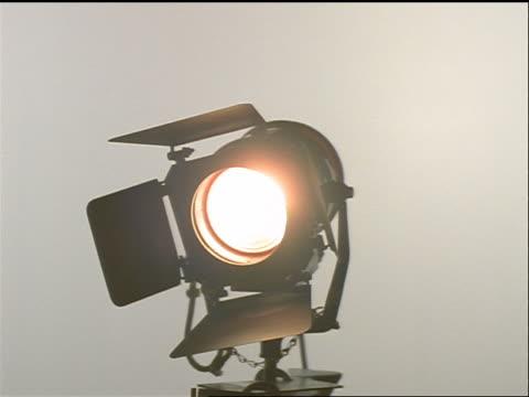 lit stage light rotating with white background - stilleben bildbanksvideor och videomaterial från bakom kulisserna