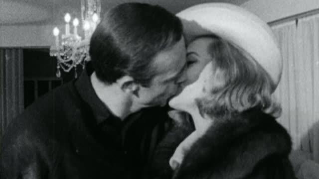 anthony horowitz writes latest bond novel fs250364001 / tx w film honor blackman being kissed by sean connery - リチャード・パロット点の映像素材/bロール