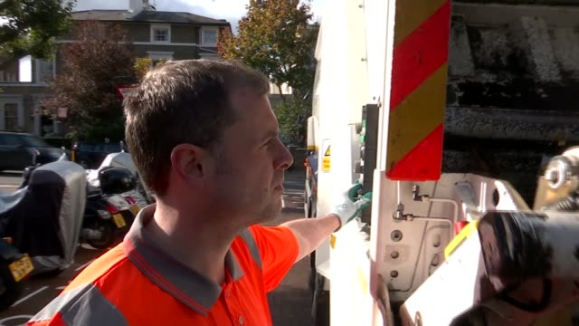 bin men write children's book about recycling; england: london: ext alessandro keningale and patrick guihen loading waste bin onto back of dustbin... - literature stock videos & royalty-free footage
