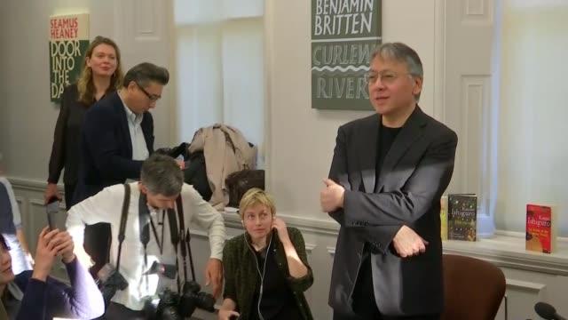 british writer kazuo ishiguro wins nobel prize for literature; england: london: int kazuo ishiguro into crowded press conference / kazuo ishiguro... - kazuo ishiguro stock videos & royalty-free footage