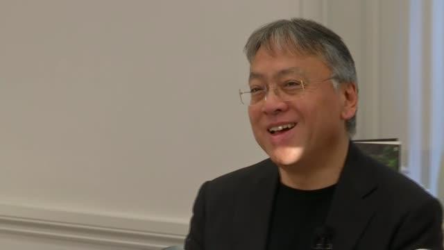 british writer kazuo ishiguro wins nobel prize for literature; england: london: int kazuo ishiguro press conference sot - kazuo ishiguro stock videos & royalty-free footage