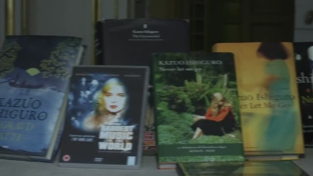 british writer kazuo ishiguro wins nobel prize for literature; london: int kazuo ishiguro books on display at press conference/ kazuo ishiguro reads... - kazuo ishiguro stock videos & royalty-free footage