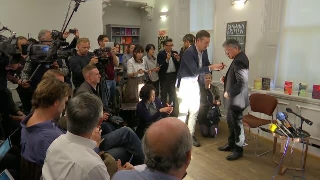british writer kazuo ishiguro wins nobel prize for literature: press conference; england: london: int kazuo ishiguro books on display / press getting... - kazuo ishiguro stock videos & royalty-free footage