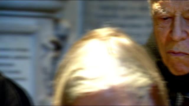 charles dickens bicentenary celebrations; england: london: westminster abbey: int charles dickens gravestone with inscription people gathered around... - charles dickens bildbanksvideor och videomaterial från bakom kulisserna