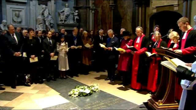 charles dickens bicentenary celebrations england london westminster abbey int prince charles laying wreath at tombstone of charles dickens close shot... - charles dickens stock videos & royalty-free footage