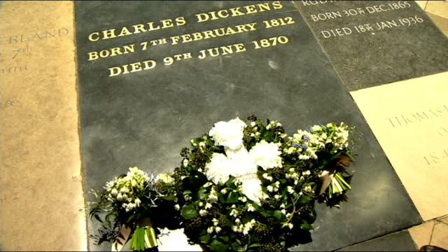 charles dickens bicentenary celebrations service at westminster abbey grave of charles dickens in poets corner in westminster abbey / people standing... - charles dickens stock videos & royalty-free footage
