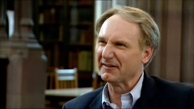 dan brown interview on new book 'inferno' england manchester john rylands library int reporter and dan brown entering through door manuscript book... - manuscript stock videos and b-roll footage