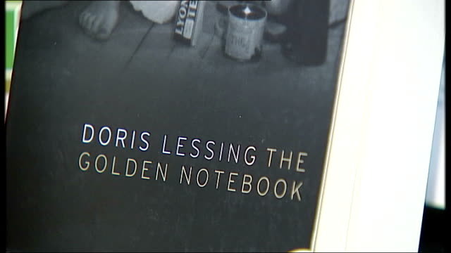 doris lessing wins the nobel prize for literature close up book cover 'the golden notebook' by lessing books written by lessing displayed on table in... - nobel prize in literature stock videos & royalty-free footage