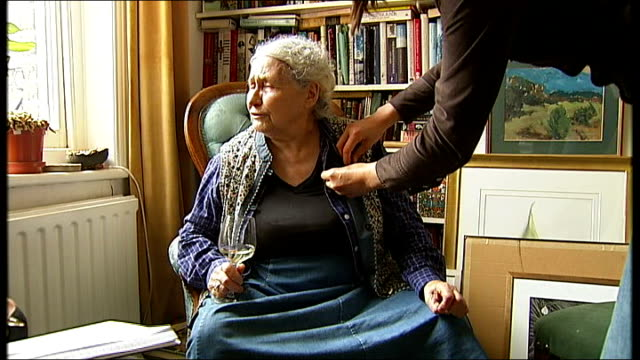 doris lessing wins the nobel prize for literature; england: london: int set-up shot of doris lessing sitting in living room as microphone is pinned... - nobel prize in literature stock videos & royalty-free footage