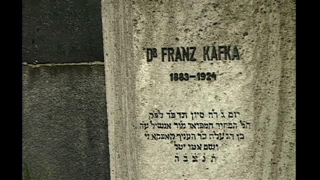 franz kafka 'unseen manuscripts' row may 1992 r22059214 / b0136304 czechoslovakia prague ext franz kafka grave and headstone in cemetery graveyard - literature stock videos and b-roll footage