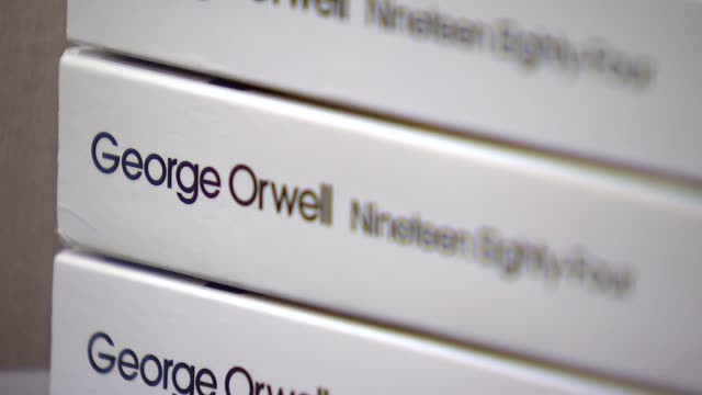 george orwell's novel '1984' on display in shop literature george orwell's novel '1984' on display in shop england london int general views of copies... - 1984 stock-videos und b-roll-filmmaterial