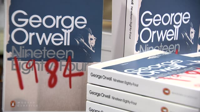increase in sales of george orwell's '1984' and 'animal farm' englandl int various shots '1984' novels on display in book store kate williams set up... - 1984 stock videos & royalty-free footage