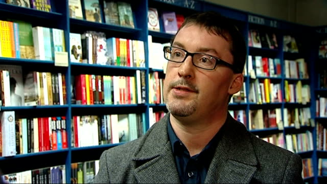 interview hilary boyd on her book thursdays in the park gv interior of book shop customers in shop close shot of till with 'welcome' message philip... - bookseller stock videos and b-roll footage