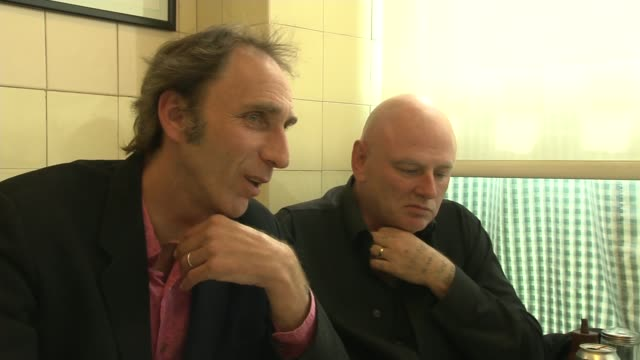 Interview with bank robber turned writer Neil 'Razor' Smith Barbed wire coils outside prison Prison windows PAN Will Self along and shaking hands...