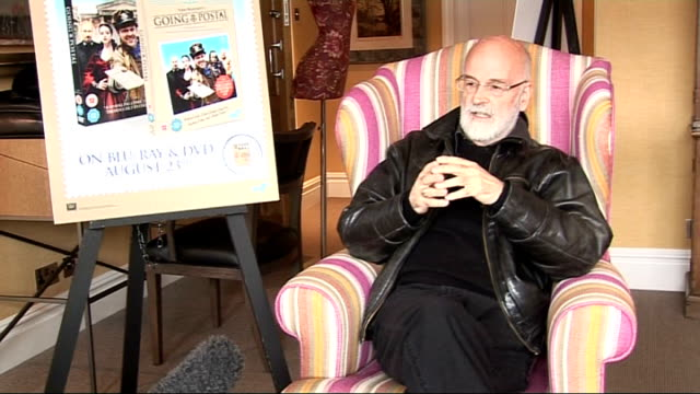 interview with sir terry pratchett; england: london: soho hotel: int sir terry pratchett interview sot - on how it feels to see you work adapted -... - cameo brooch stock videos & royalty-free footage