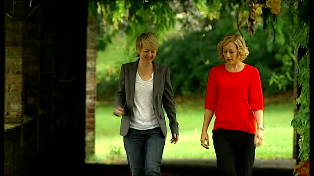 vídeos de stock, filmes e b-roll de interview writer sarah waters; england: london: ext set-up shots of reporter walking with sarah waters - cathy newman