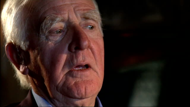 john le carre interview; cornwell interview sot - about how the book changed his life and expressed his feelings about his political and personal... - デビッド コーンウェル点の映像素材/bロール