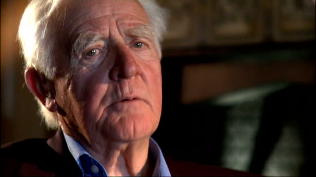 john le carre interview; cornwell interview sot - on how he wanted to feel there was a decent product at the end of the cold war. - literature stock-videos und b-roll-filmmaterial