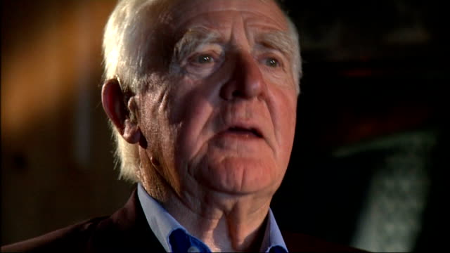john le carre interview; cornwell interview sot - on successful writers have one benchmark book and how 'the spy who came in from the cold' was that... - デビッド コーンウェル点の映像素材/bロール