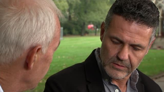 khaled hosseini interview on 'sea prayer'; england: london: westminster: ext various of reporter and hosseini khaled hosseini interview sot. cutaways... - literature stock videos & royalty-free footage