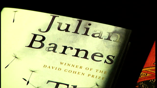 man booker prize 2011 shortlist announced england int various close shots of covers of the six shortlisted novels julian barnes the sense of ending... - temperate flower stock videos and b-roll footage
