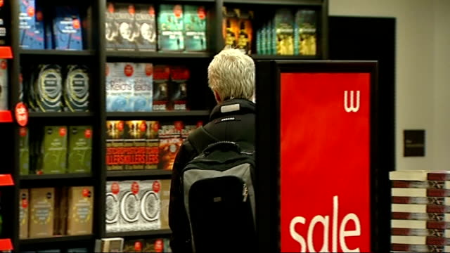 man booker prize 2011 shortlist announced various shots of people looking at books and bookshelves in waterstone's bookshop - man booker prize stock videos & royalty-free footage