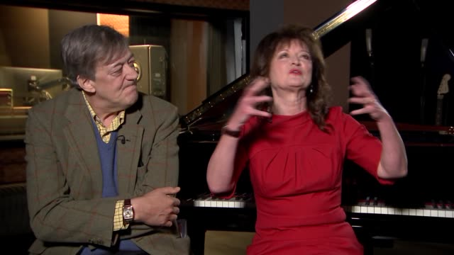 'the mythos suite': stephen fry and debbie wiseman interview; england: london: int stephen fry and debbie wiseman interview continued sot - re greek... - スティーブン フライ点の映像素材/bロール