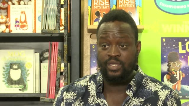 nathan bryon and dapo adeola win children's book prize england int dapo adeola and nathan bryon set up shots with reporter / interview sot... - looking up stock videos & royalty-free footage